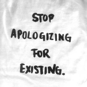 T-Shirt by Milk 'Stop Apologising for Existing'